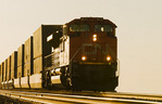 a locomotive pulls rail cars carrying containers near Winnipeg, Manitoba, Canada