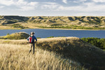hiker, Saskatchewan Landing Provincial Park with Lake Diefenbaker in the background, ,  Saskatchewan, Canada