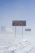 signage along Trans-Canada Highway east of Winnipeg during the winter, Manitoba, Canada