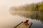Muskoka chair on dock, Dickens Lake,  Saskatchewan, Canada