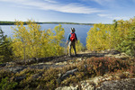 hiker looking out over Devil Lake, Northern Saskatchewan, Canada