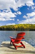 Muskoka chair on dock, Glad Lake , Duck Mountain Provincial Park, Manitoba, Canada