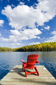 Muskoka chair on dock, Glad Lake , Duck Mountain Provincial Park, Manitoba, Canada