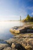 Canadian Shield rock and lake, Namau Lake, Whiteshell Provincial Park, Manitoba, Canada