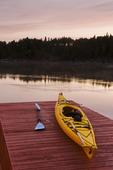 kayak on on dock at sunrise,  Lake of the Woods, Northwestern Ontario, Canada