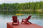 Muskoka chairs on dock, Lake of the Woods, Northwestern Ontario, Canada