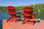 Muskoka chairs on dock, Lake of the Woods, Northwestern Ontario, Canada