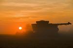 a combine harvester works in a yellow field pea field near Winnipeg,  Manitoba, Canada