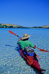 Kayaker paddles off Yasawa Islands, Fiji