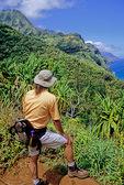 Hiker on the Kalalau Trail in Kauai sees the Na Pali Coast