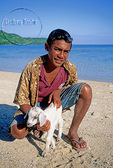Boy in Fiji with pet goat