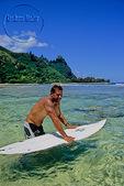 Surfer at Tunnels Beach on Kauai