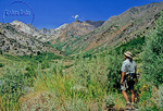 Hiker on trail in McGee Creek canyon in the Eastern Sierra Nevada