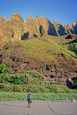Hiker below fluted cliffs at Kalalau Beach 