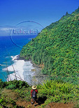 Hiker on the Kalalau Trail looks at Hanakapiai Beach