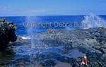 Man watches Nakalele Blowhole on Maui