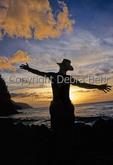 Silhouettes at sunset at Kee Beach on Kauai