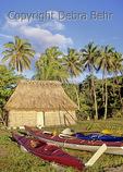 Kayaks by bure in the Yasawa Islands in Fiji
