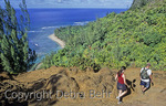 Couple on the Kalalau Trail on Kauai with view of Kee Beach in the distance
