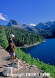 Hiker and white dog look at South Lake