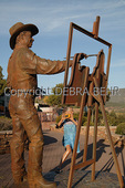 "Cowboy painter sculpture by Clyde ""Ross"" Morgan in downtown Sedona"
