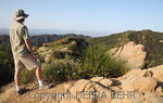 Hiker at Topanga State Park in Southern California looks at Eagle Rock