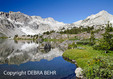Peaks reflected in lake at 20 Lakes Basin in California