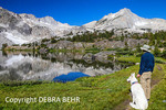 Hiker and White German Shepherd rest at 20 Lakes Basin