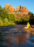 Relaxing hiker gazes at Cathedral Rock in Sedona