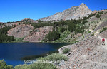 Hiker looks at Blue Lake in the Virginia Lakes area of the Eastern Sierra