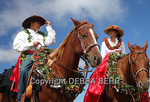 Big Island children prepare to be keiki pau riders in the 35th annual Waimea Paniolo Parade