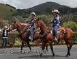 Riders participate in the 35th annual Waimea Paniolo Parade on the Big Island