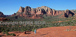 Hiker stops along the Bell Rock Trail to enjoy the view