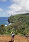 Hiker ventures on trail into Pololu Valley on the Big Island