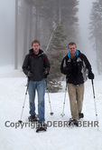 Men wearing snowshoes at Badger Pass area of Yosemite National Park