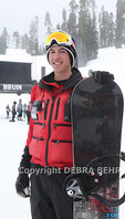 Ski patrol member at Badger Pass in Yosemite National Park with his snowboard