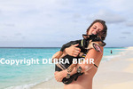 Woman holding her dog at Shoal Bay in Anguilla