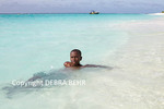 Boy in sea at Shoal Bay on Anguilla
