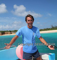 Staff member of Aqua Mania Adventures on boat by Tintamarre, a day trip from St Maarten/Martin