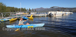 Kayaker in Big Bear Lake by Captain John's Fawn Harbor and Marina