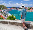 Visitor looks at harbor at Gustavia in St. Barts