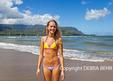 Young woman at Hanalei Bay on Kauai