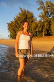 Woman in golden light at Kee Beach on Kauai