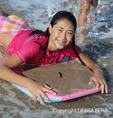 Girl on boogie board at Hanalei Beach on Kauai