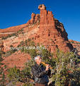 Arizona man plays Native American flute under the Kachina Woman rock formation in Sedona