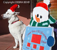 White German Shepherd by holiday sign