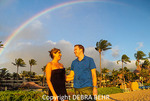 Couple under rainbow at Kaanapali Beach, Maui