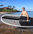 Stand up paddle boarders and snorkelers explore sea off Wailea, Maui
