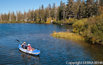 Dog in kayak with couple at Twin Lakes in the Mammoth Lakes Basin
