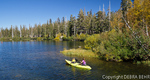 Woman and child kayaking in Twin Lakes in Mammoth Lakes Basin